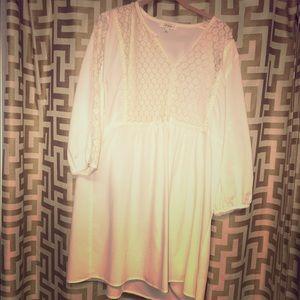 Cream colored dress/long shirt.